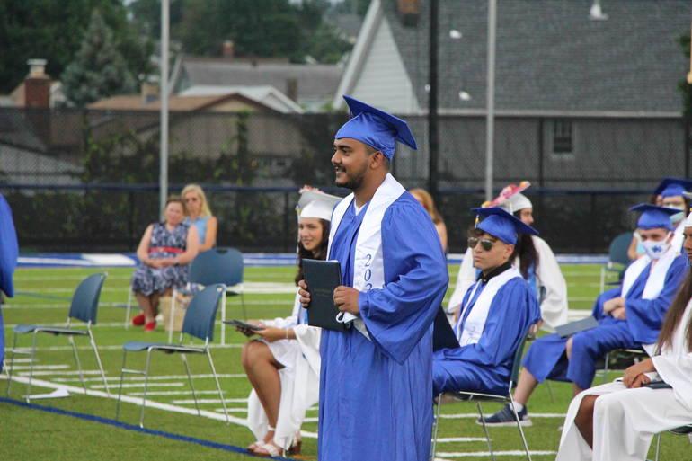 EDIT boy student gets diploma.jpg
