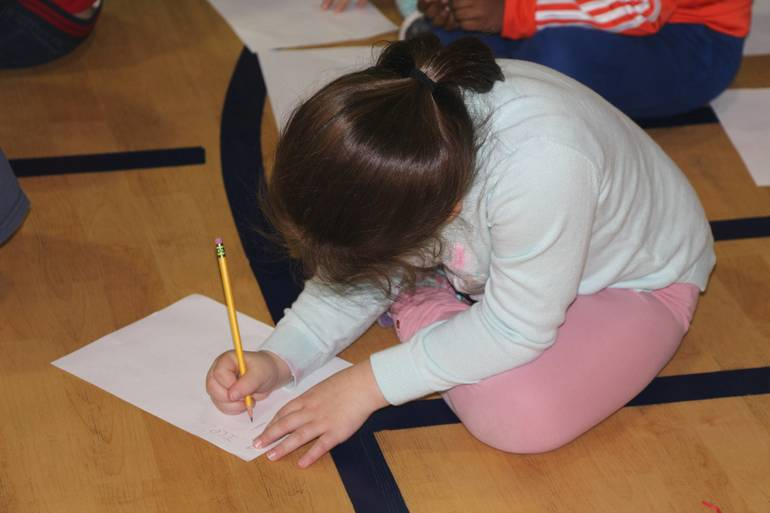 EDIT child writing.jpg