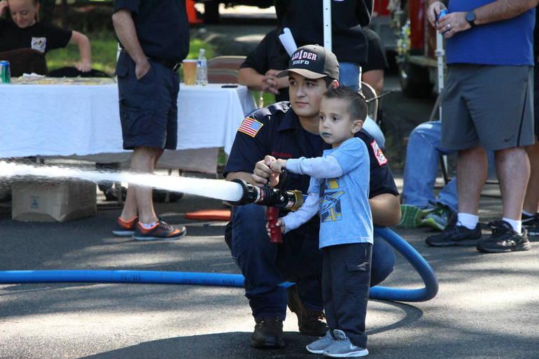 EDIT boy with fire hose.jpg