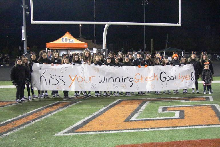 EDIT JUNIORS cheerleaders with banner.jpg
