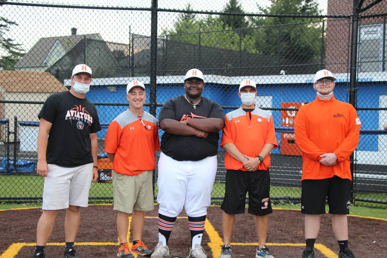 EDIT Andre Brown with coaches.jpg