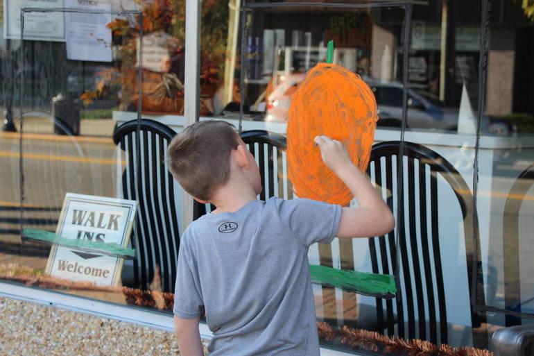 EDIT boy painting a pumpkin.jpg