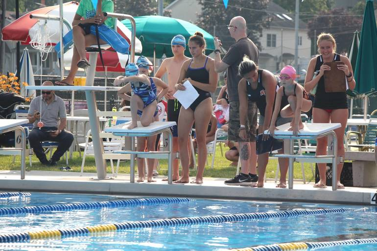 EDIT coach with swimmer on the blocks.jpg