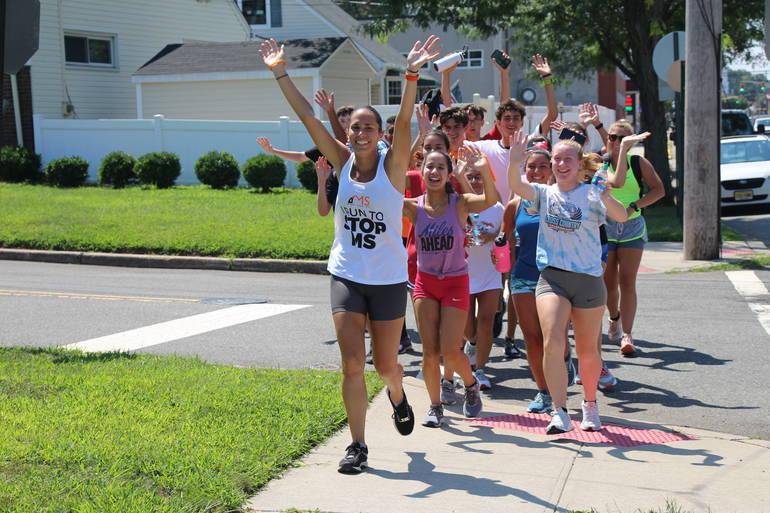 EDIT group running waving.jpg