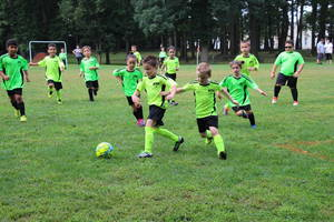 Carousel image 13f0df5fcbbc33b7cee7 edit green yellow boys fight for the ball