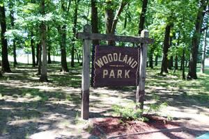 Carousel image feac712d2c0e4930588d edit woodland park sign