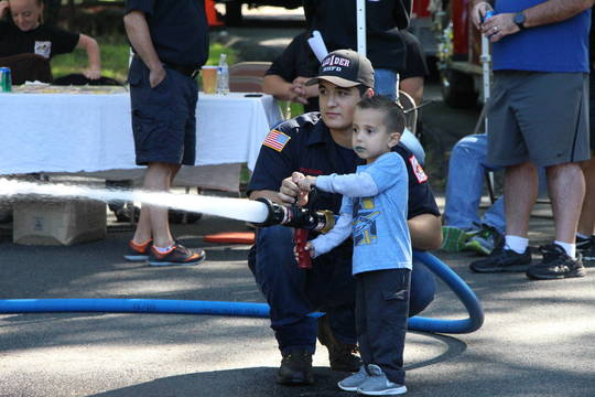 Top story 78fe5786244f314059a6 edit boy with fire hose
