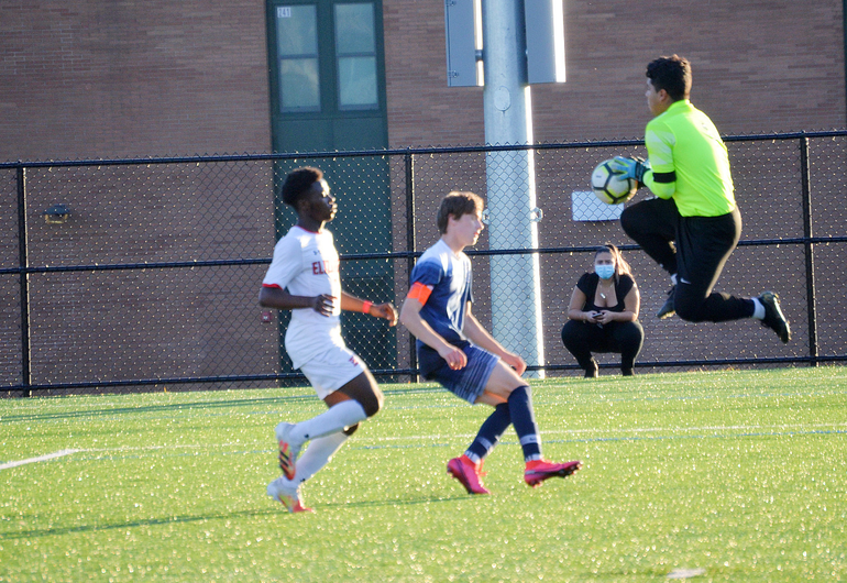 Elizabeth goalie Dylan Valencia makes a leaping save.