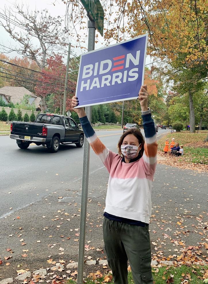 Scotch Plains Council candidate Ellen Zimmerman holds up a Biden sign