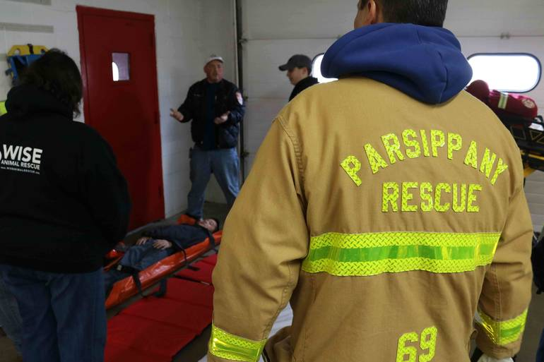 EMTs-and-First-Responders-discuss-procedure-for-properly-lifting-and-tra....jpg