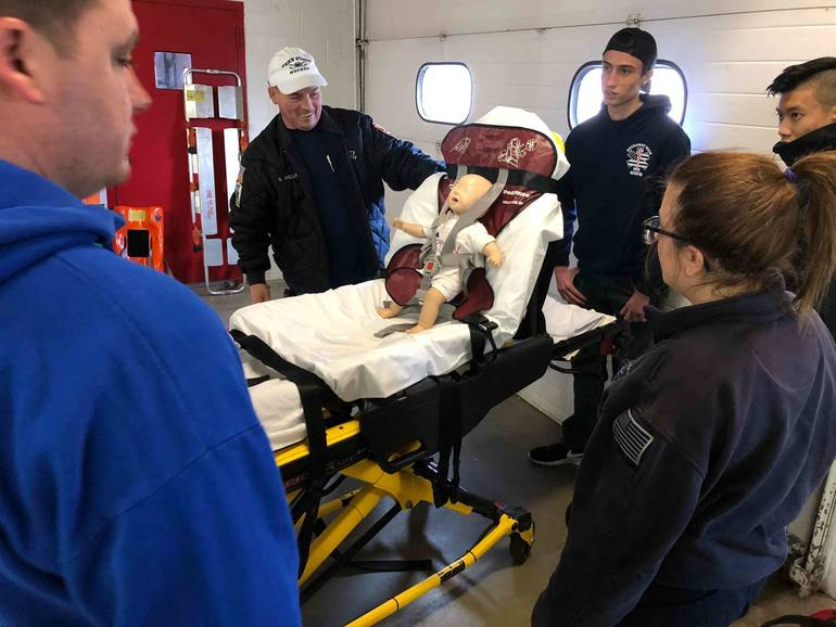 EMTs-show-the-proper-procedure-for-loading-infants-on-stretchers-PHOTO-B....jpg