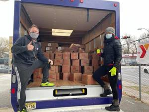 YMCA staff with a truckload of food boxes.
