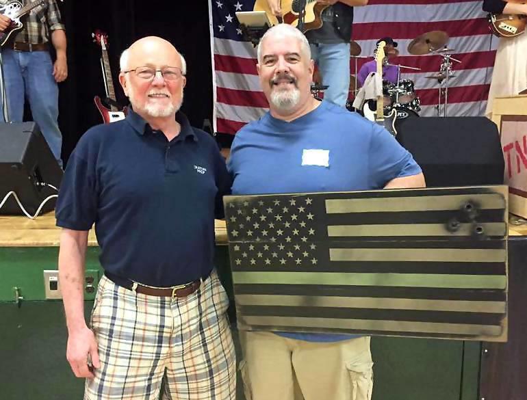 Veterans, including Seth (left), appreciate Scotch Plains resident Ernie Hernandez's flag art.