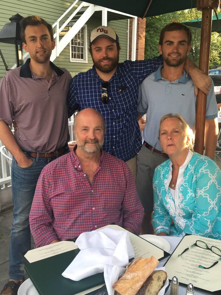 Erik (center) and family.JPG