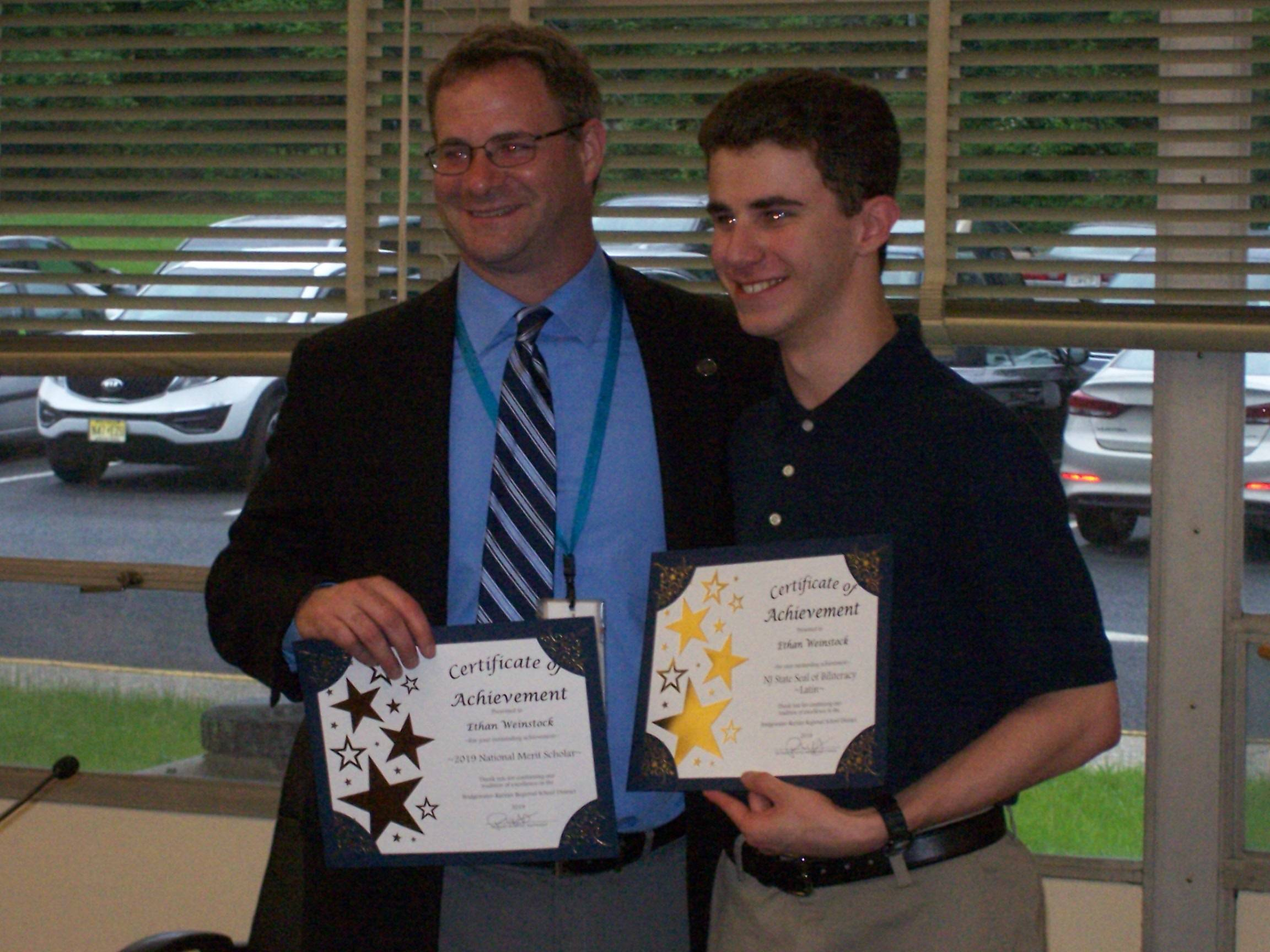 Ethan Weinstock and Superintendent Russell Lazovick