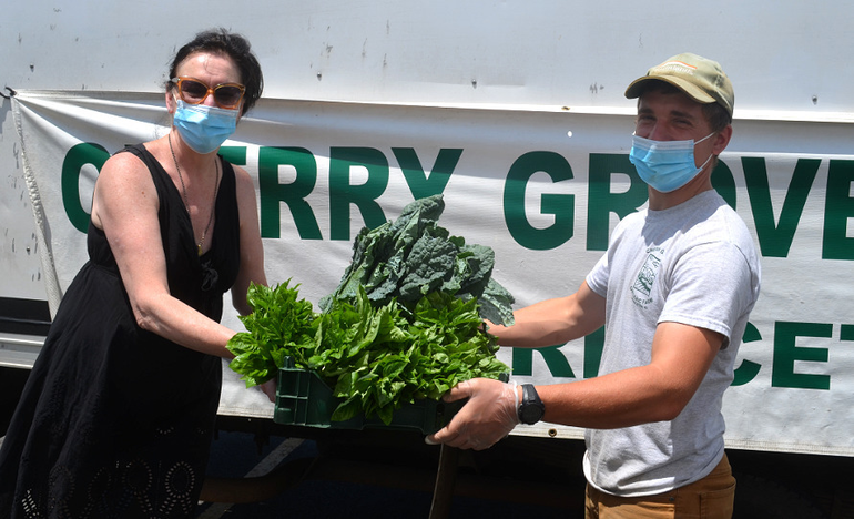 Eva Pfaff buys vegetables from Cherry Grove Organic Produce that she will sell at the Fanwood Larder.