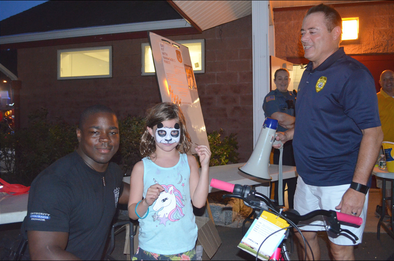 Fanwood police officer Tim Green with prize winner and Chief Richard Trigo.png