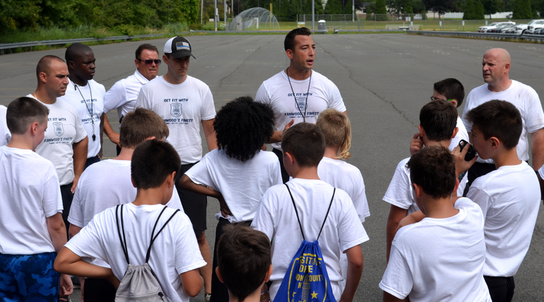 Fanwood police officer Elliott Bernard recaps the day for young participants.png