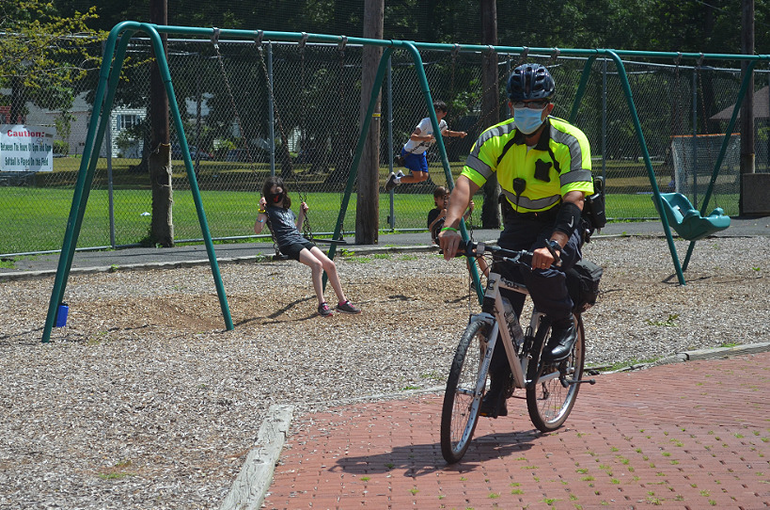 Fanwood police officer Kevin Stomber patrols LaGrande Park by bicycle.png
