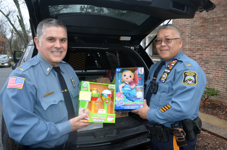 Fanwood Police Giving Tree - Lt. Francisco Marrero and Lt. Eugene Chin of the Fanwood Police Dept..png
