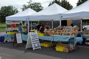 Farmer's Market Sowing Seeds for Season Opening