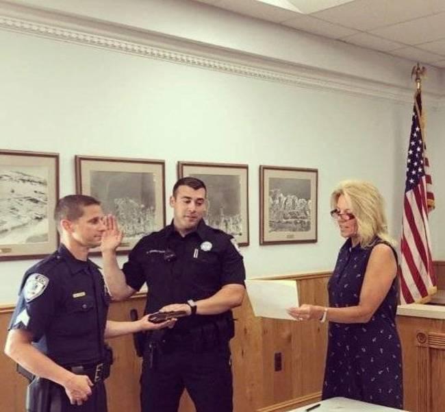 Officer Dan Grundtisch being sworn in.