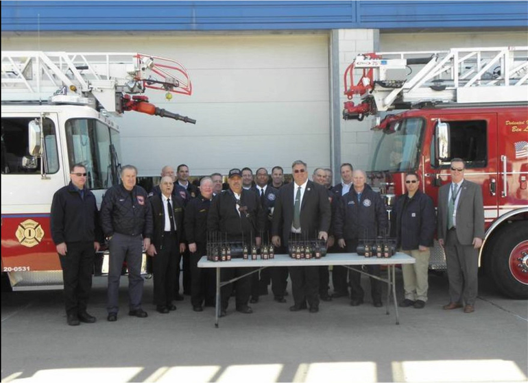Freeholder Chair Al Mirabella presents new radios to the Fanwood Fire Dept. and firefighters from other towns.
