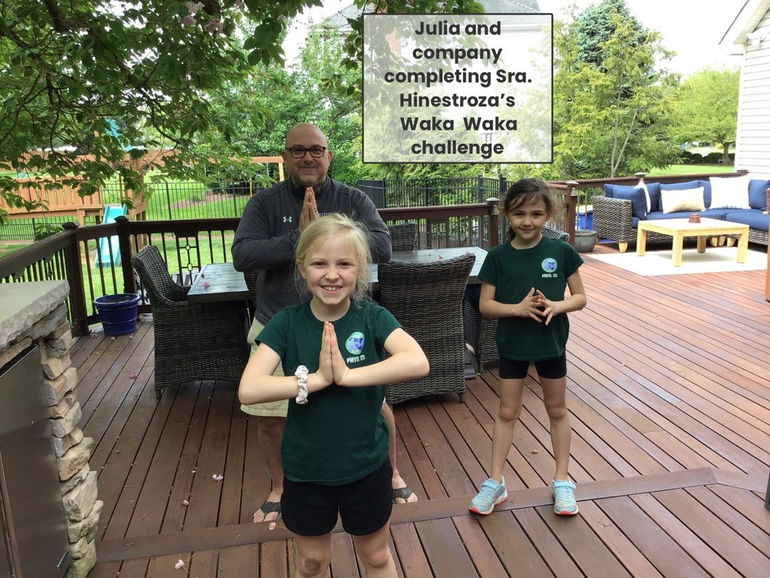 Sisters Julia and Grace Gonnella of Hillsborough, with their dad Gerard Gonnella, participate in one of the many challenges on Field Day.