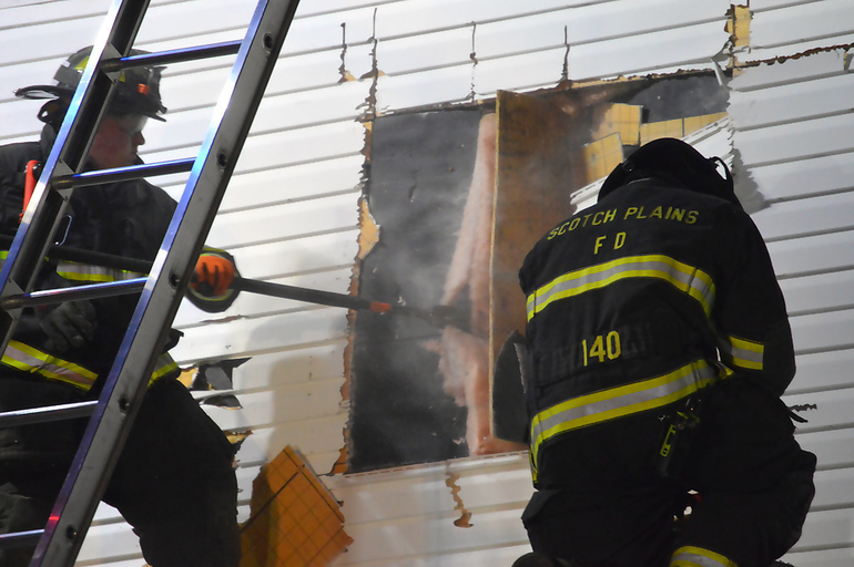 fire6 - firefighters practice demolition skills atop vacated rectory.png