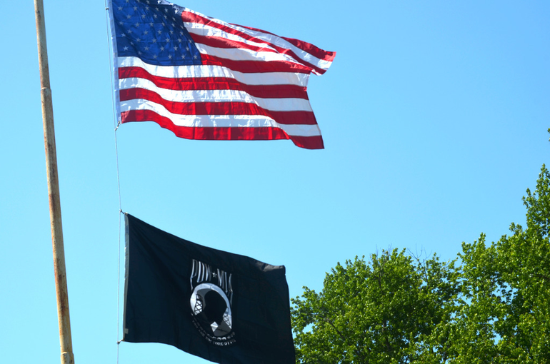 U.S. flag and POW/MIA flag fly at Fanwood Memorial Library