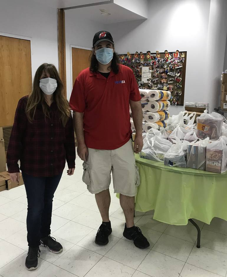 FLEA member Jeanine Hayek & PCTVEA Treasurer Michael Pettineo delivering food and supplies to The Senior Center in Passaic, 5-22-2020.jpeg