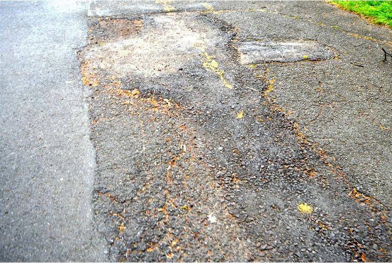 Forest Road Park in Fanwood - broken asphalt.png