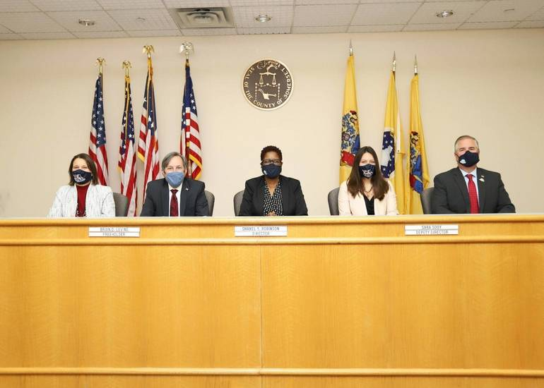 Somerset County Freeholders Melonie Marano and Brian Levine, Freeholder Director Shanel Robinson, Freeholder Deputy Director Sara Sooy, and Freeholder Brian Gallagher after completing the final meeting of the Somerset County Board of Chosen Freeholders as it transitions to the Somerset County Board of Commissioners.