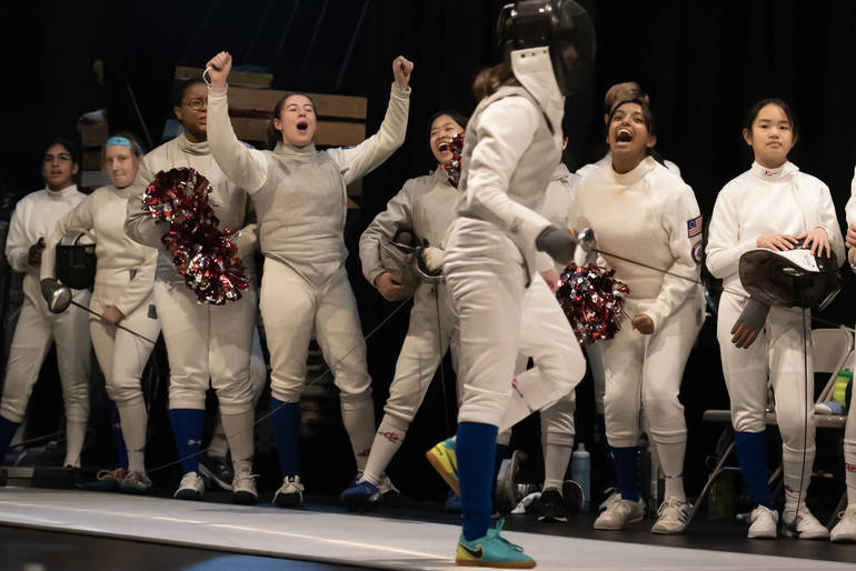 Freshman foil Waverly Lorne cheered on by teammates during a winning bout on Super Saturday  Berkow.jpg