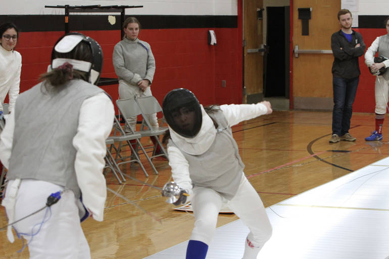 Freshman foil Waverly Lorne faces a left-handed opponent in her third bout and wins.jpg