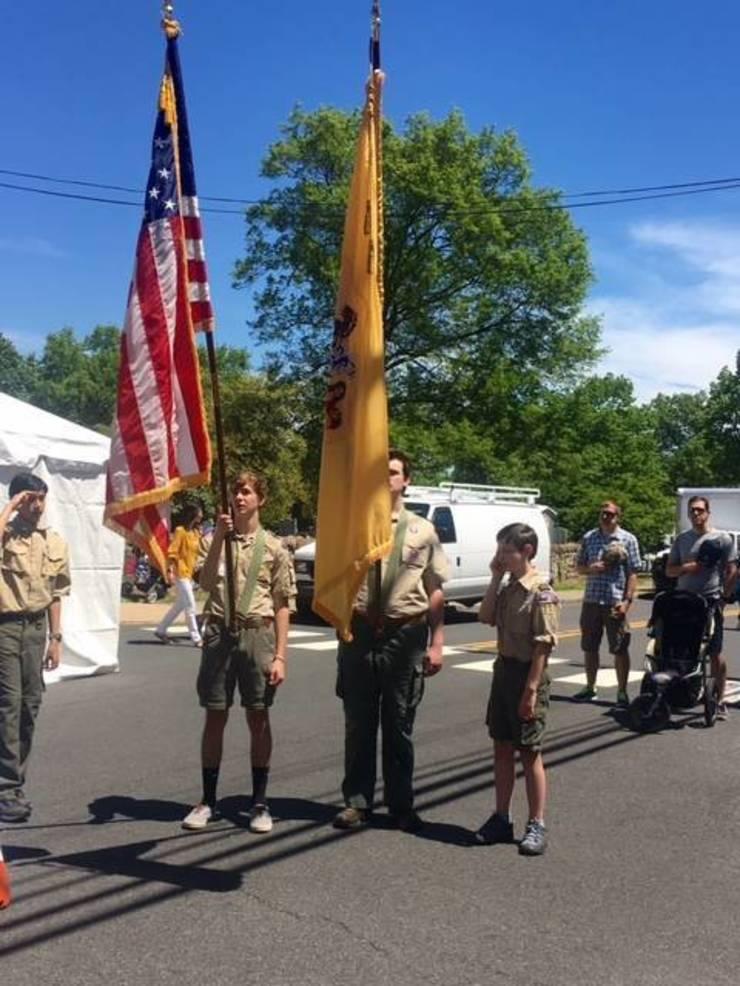 Boy Scouts raise the flag