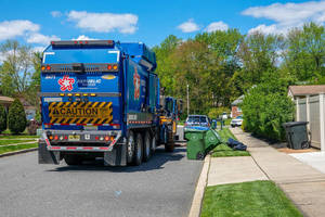 Carousel image c8a83c0176ace3374e3f garbage truck collects trash on residential street in cherry hill  alan budman