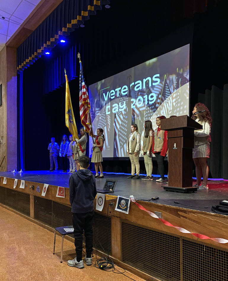 Girl Scout Troops 95137 and 96195 present the colors.jpg