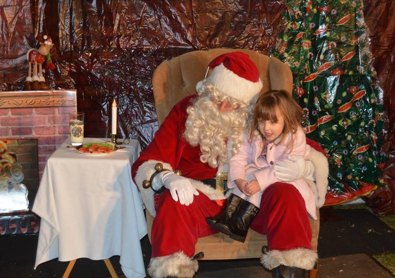 Girl sits on Santa's Lap at Fanwood tree lighting.jpg