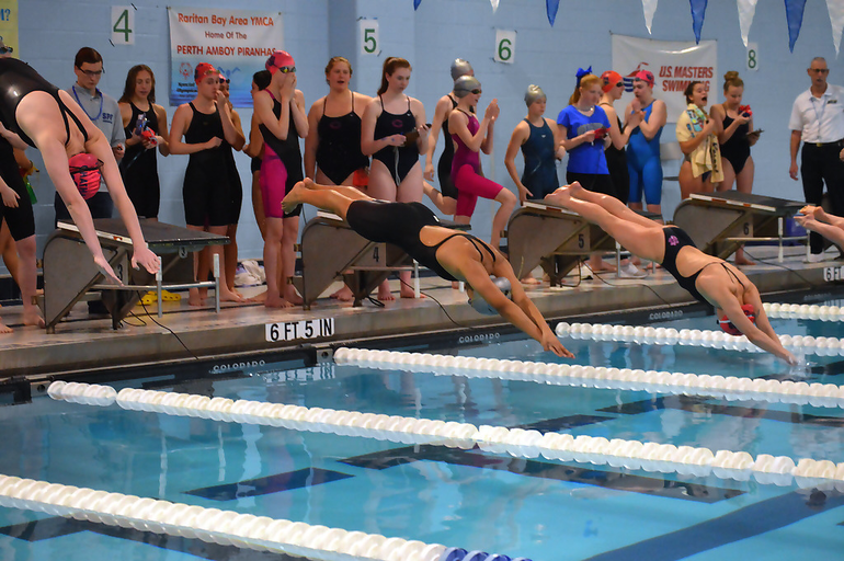Girls dive to start race.png