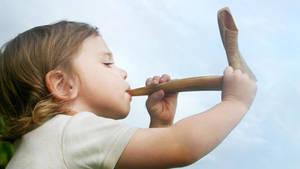 Carousel image 608747b8ef40907bd2e0 girl blowing shofar
