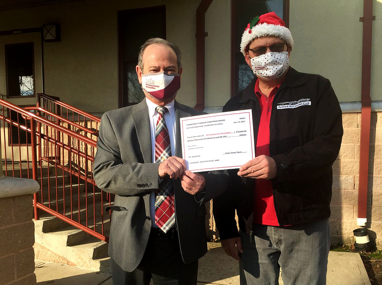 Greg Roser, creator of Fanwood's Famous Christmas House, presented a ceremonial check to Robert J. Ferrara, executive director of the New Jersey NJ Institute for Disabilities.