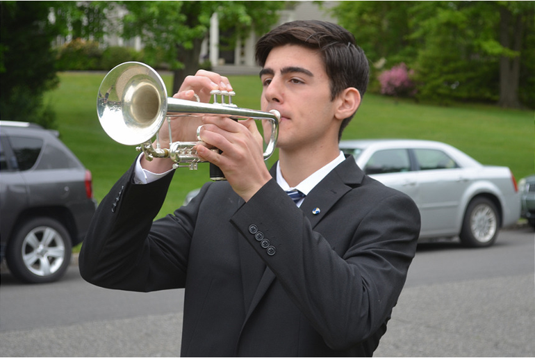 "Griffin Coolidge of Fanwood played ""Taps."""