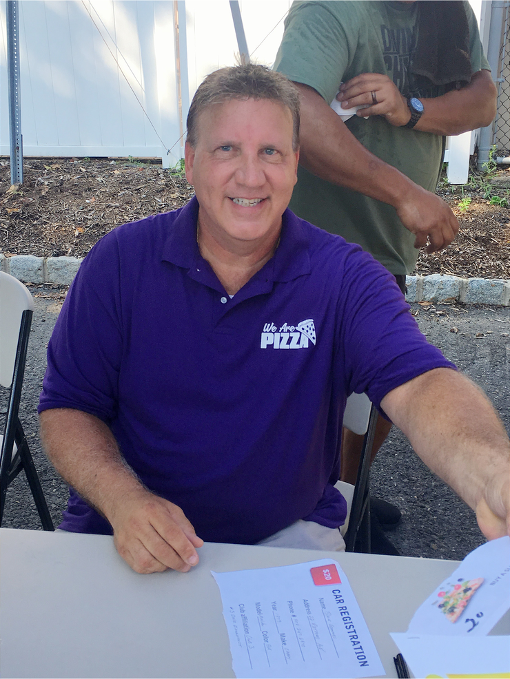 Greg Kowalczyk signing in registrants at the classic car show at Fanwood train station.