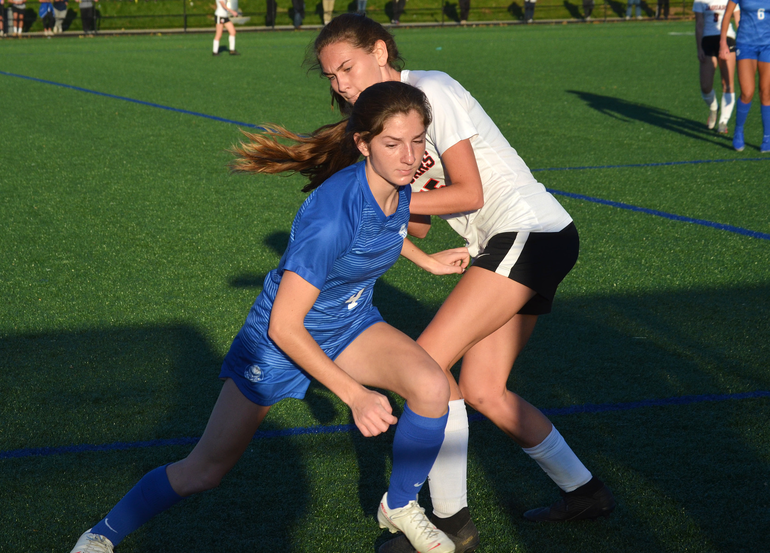 Scotch Plains-Fanwood's Grace Kennedy battles for the ball.