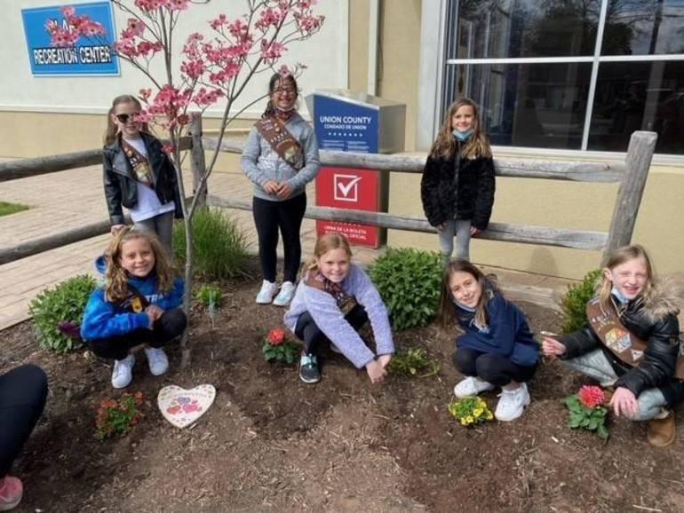 Brownie Troop 40483 Sowing Seeds of Thanks to Clark Recreation