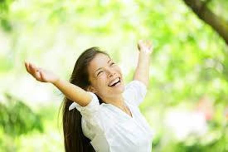 happy woman in nature stock photo.jpg