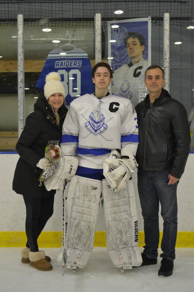 #30, Captain, Paul Harris with his parents at at Scotch Plains-Fanwood hockey Senior Night.