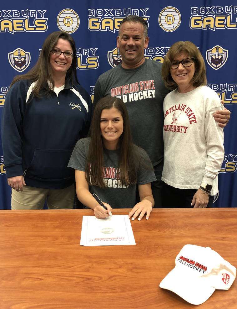 Hannah Legotte w Coach Douglas and Parents.jpg