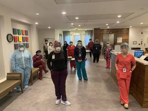 Carousel image a32a5a7aa250abfb10f1 healthcare workers ppe social distancing